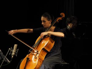 Marina Martins plays the cello with Leandro Roverso by the piano